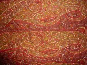The same silk fabric with Running stitches added around areas of the pattern